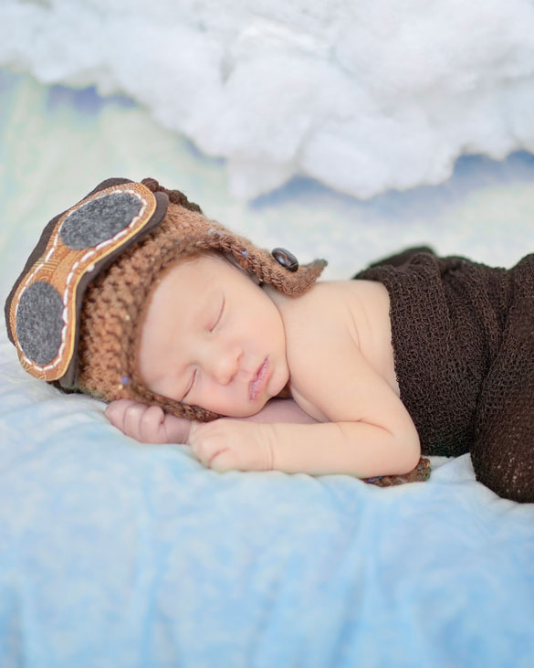 Newborn photography buffalo ny baby pilot taking a nap in this wonderful newborn photography session by samantha mcallister photography