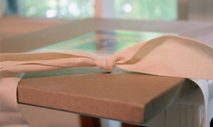Recycled package with ribbon and card for photo prints.